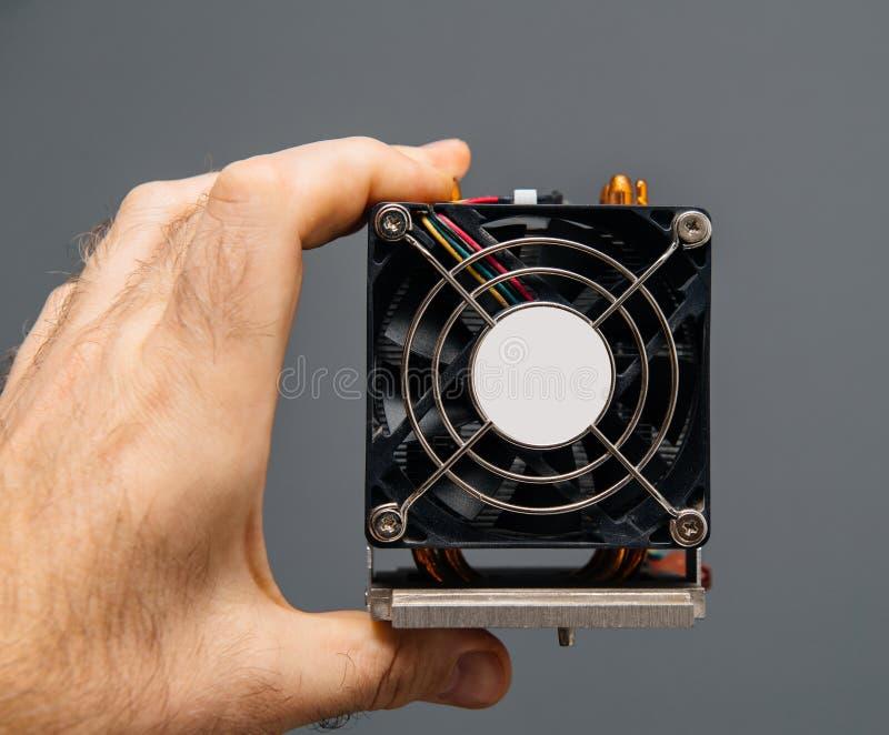 Man hand holding CPU fan heatsink cooler replacement stock photos