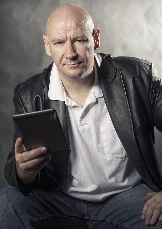 Man holding e-reader tablet royalty free stock photos