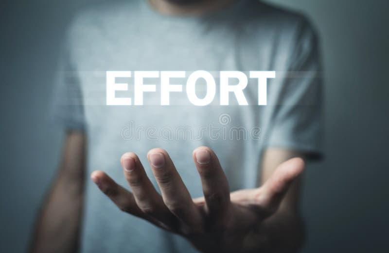 Man holding Effort word. Business concept stock image