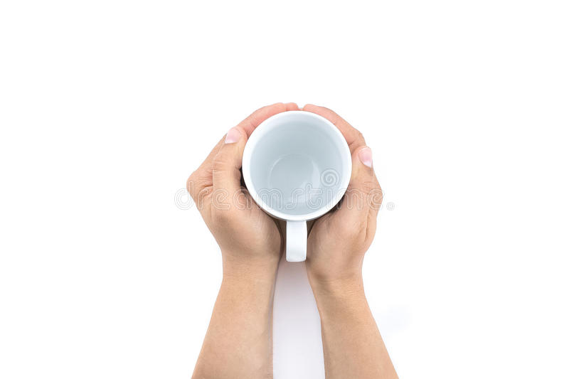Man holding empty cup of milk on white table royalty free stock photos