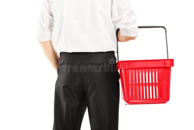 Man holding an empty shopping basket royalty free stock photos
