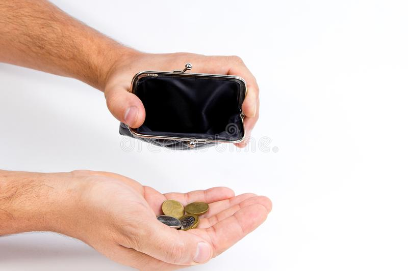 Man holding an empty wallet over an empty hand . The concept of poverty. stock photos