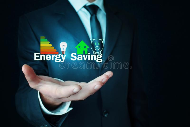 Man holding Energy Saving concept. stock photo