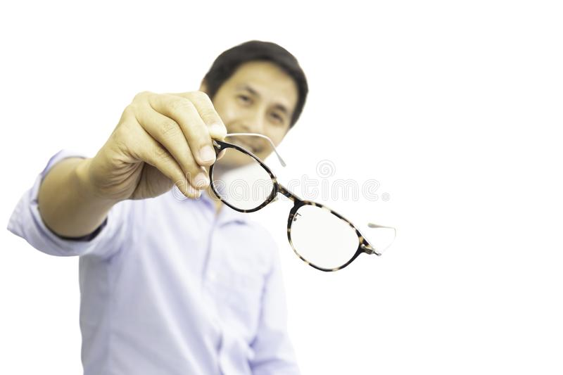 Man holding eyeglasses for a try out isolated in clipping path. royalty free stock photos