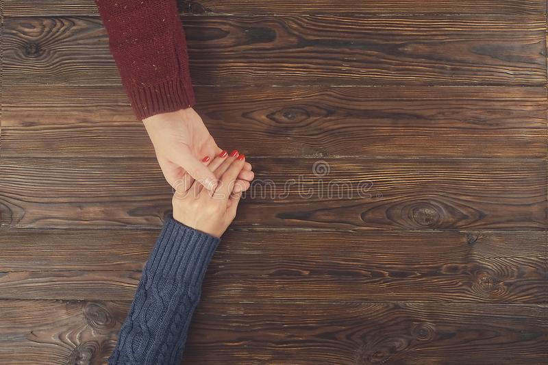 Man holding female hand top view copy space. Couple in love. stock images