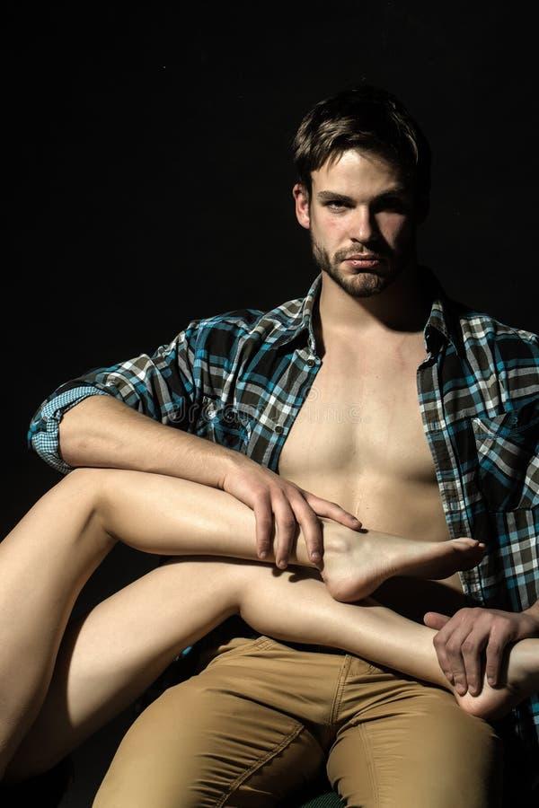 Man holding female legs stock images