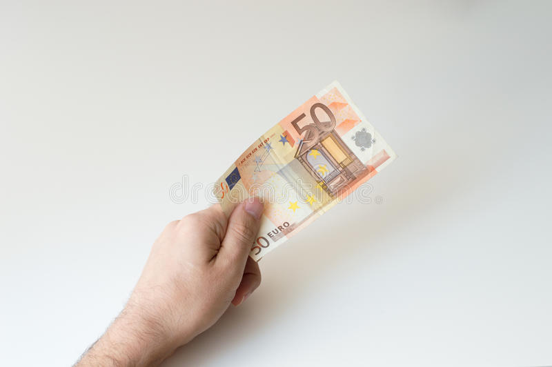 Man holding fifty Euro banknote. In his hands royalty free stock photos