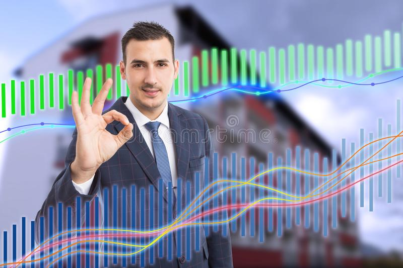 Man holding fingers as okay gesture for economy concept stock photos