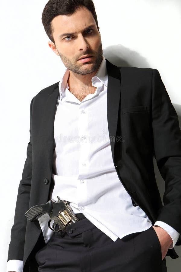 Man Holding a fire gun and smoking stock photo