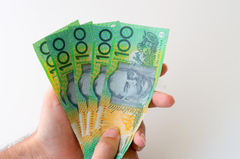 Man holding five hundred Australian Dollar banknote. In his hands royalty free stock photo