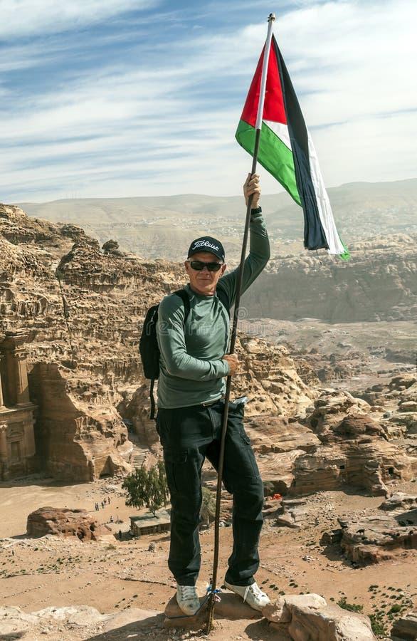 Man holding the flag of Jordan stock photo