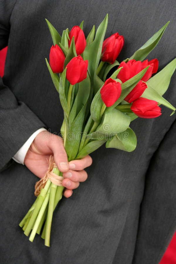 Man Holding Flowers royalty free stock photo