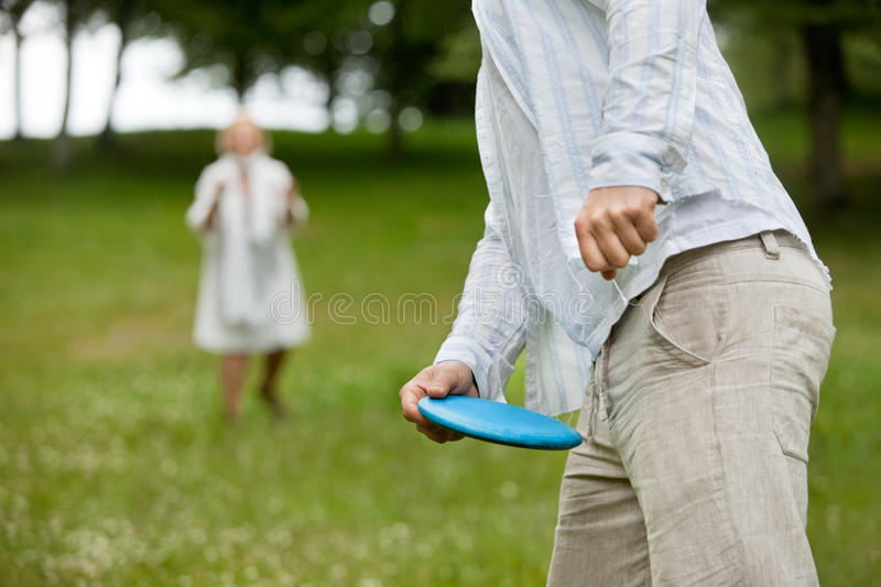 Man Holding Flying Disc royalty free stock photography