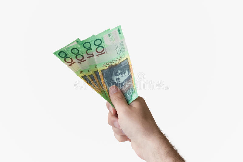 Man holding four hundred Australian Dollar notes in his hand. Man holding four hundred Australian Dollar banknotes in his hand royalty free stock photo