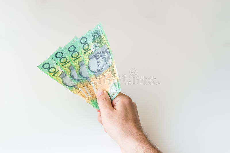 Man holding four hundred Australian Dollar notes in his hand. Man holding four hundred Australian Dollar banknotes in his hand stock image