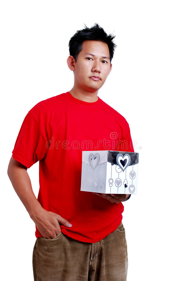 Man holding a gift box royalty free stock photo