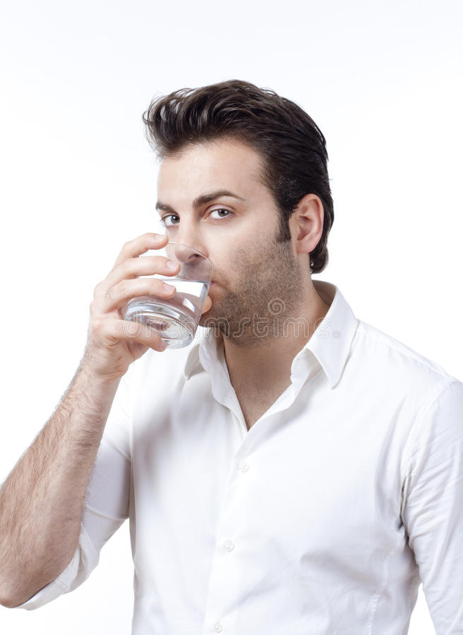 Man holding glass of water stock images