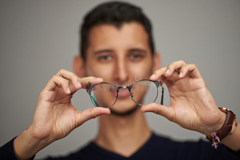 Man holding glasses in hands stock images