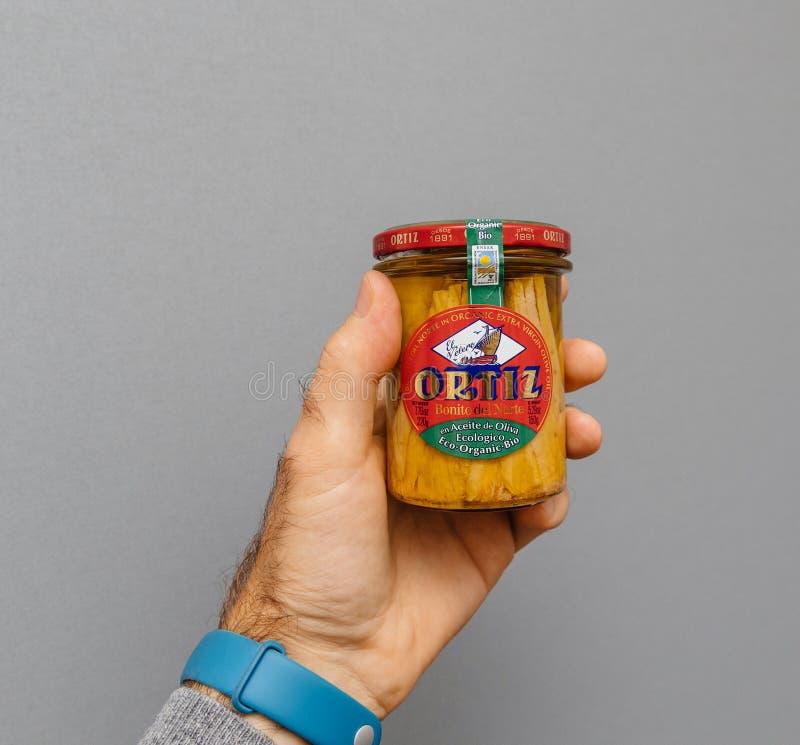 Man holding glazz ORTIZ ecologic bio organic jar with Albacore royalty free stock photos