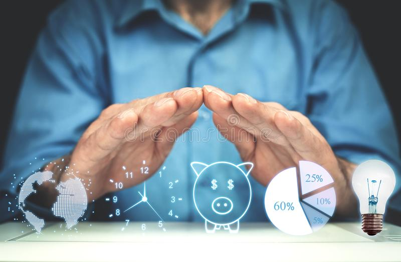 Man holding globe, clock, piggy bank, pie graph and light bulb. Business concept royalty free stock images
