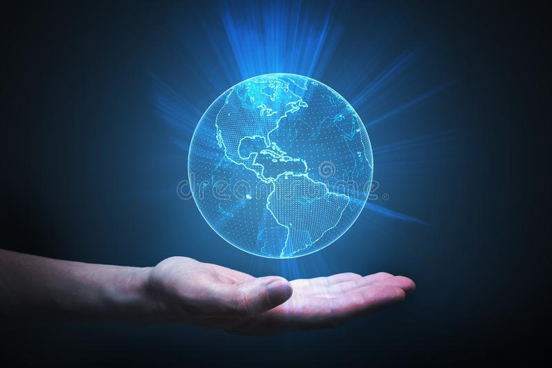 Man is holding glowing globe in hand. Global network concept. royalty free stock image