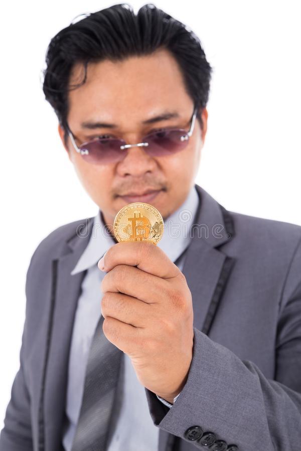Man holding golden bitcoin in hand isolated on white background stock images