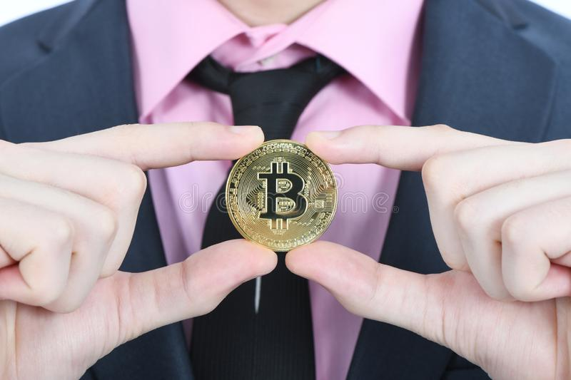 Man holding golden Bitcoin isolated on white stock images