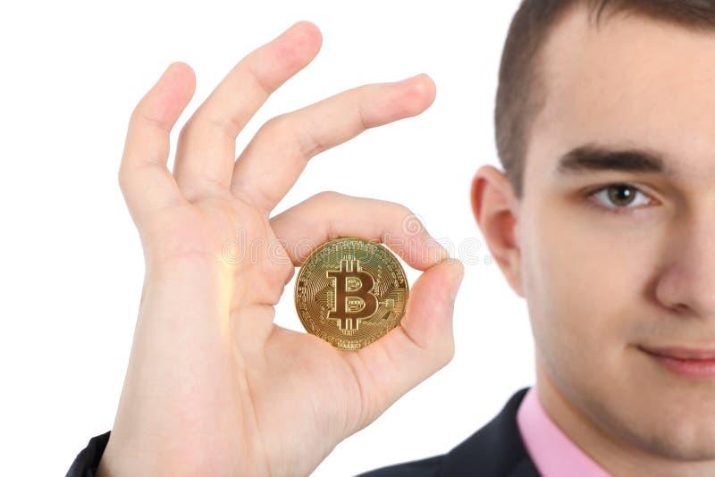 Man holding golden Bitcoin isolated on white stock photos