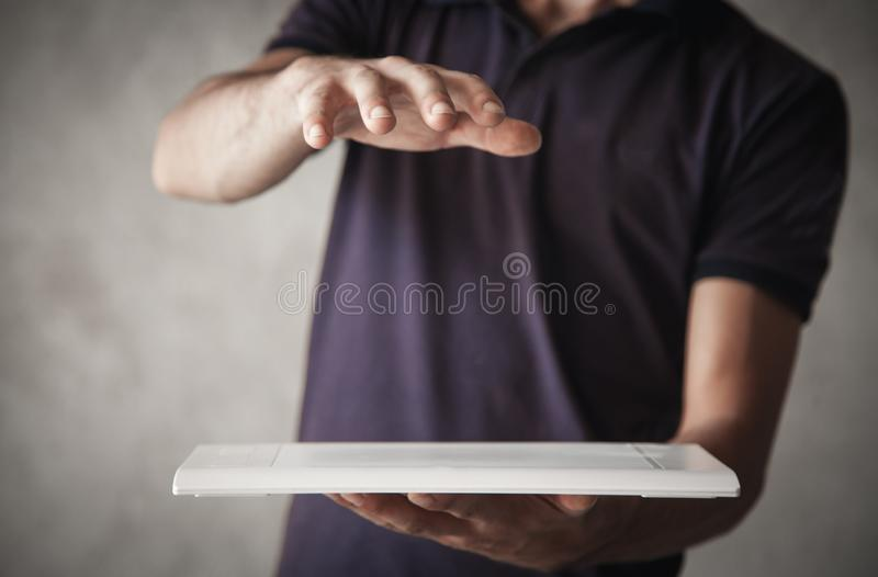 Man holding graphic tablet with protect gesture stock image