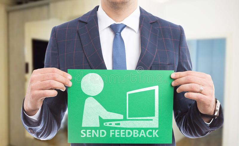 Man holding paper with send feedback text and drawing stock images