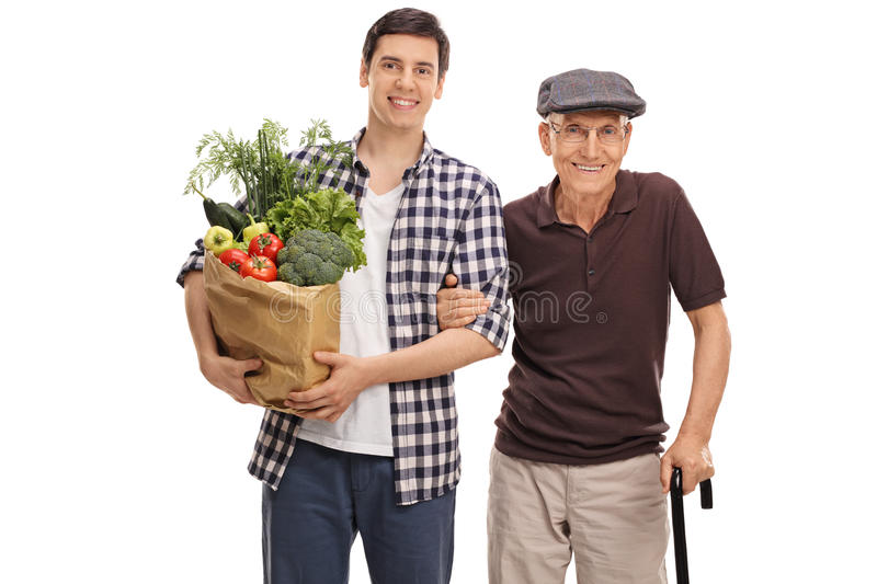 Man holding groceries with his grandpa stock image