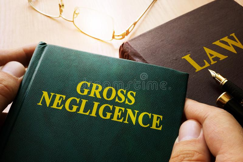 Man holding Gross Negligence. Man holding Gross Negligence book stock photo