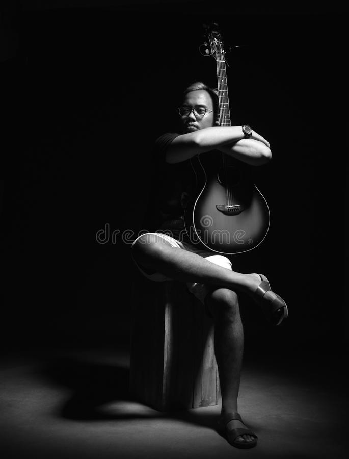 Man holding guitar royalty free stock photography