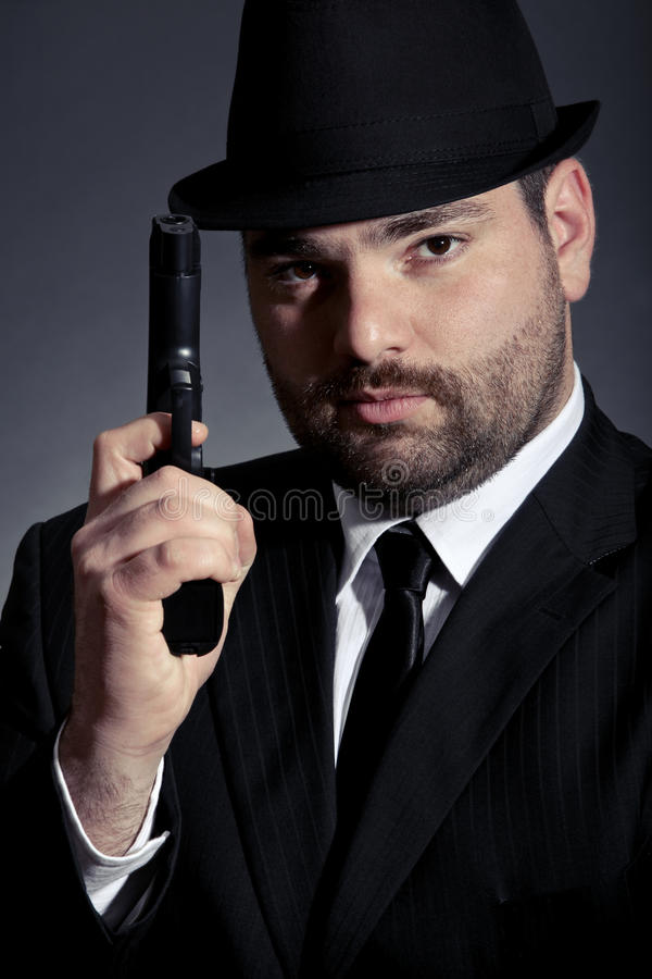 Download Man holding a gun stock photo. Image of revolver, action - 23259686