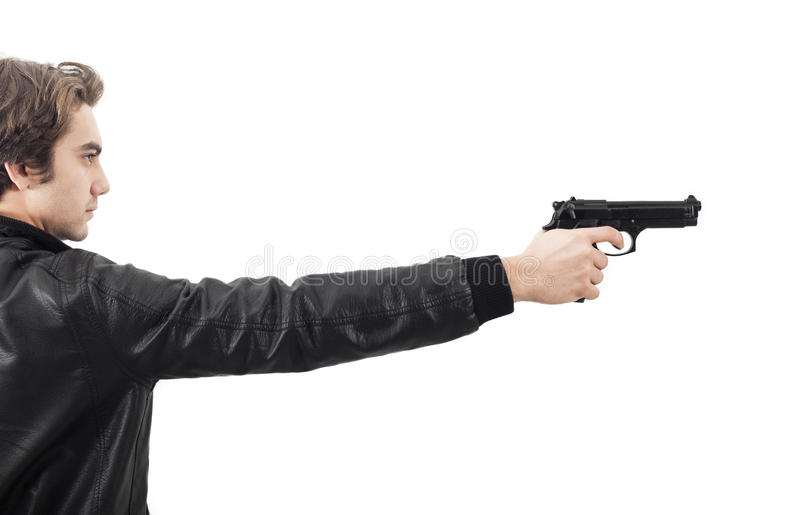 The man holding a gun. Isolated stock photography