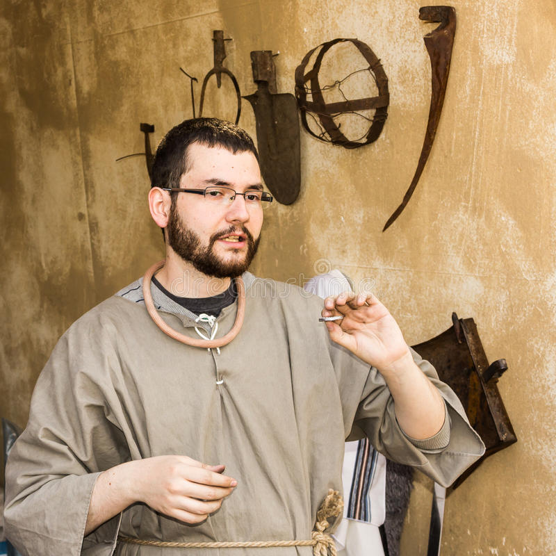 A man holding Half Shekel Coin. Hand Holding Half Shekel Coin in Biblical Village. The Biblical Village is the first project in Europe organized in Bucharest at royalty free stock image