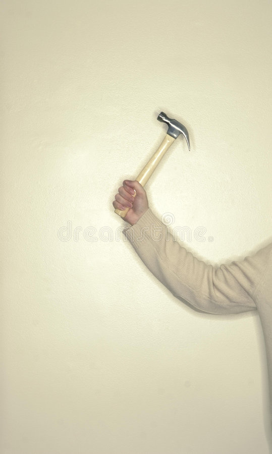 Man holding hammer stock photography