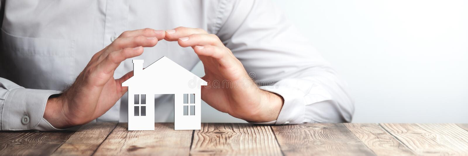 Protecting Hands Over House royalty free stock photography