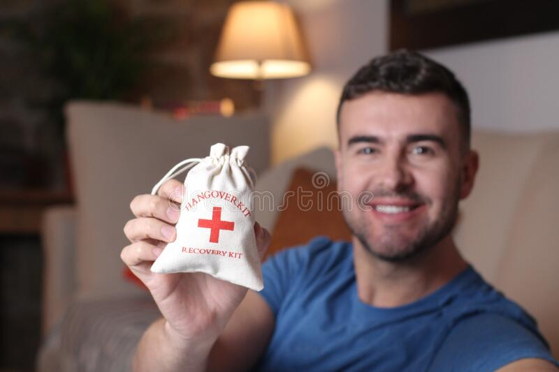 Man holding a hangover kit stock photo