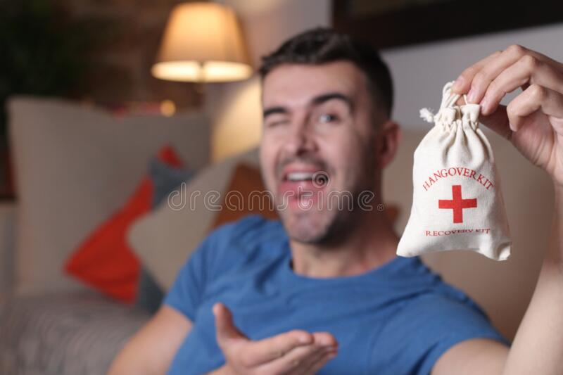 Man holding a hangover kit royalty free stock image