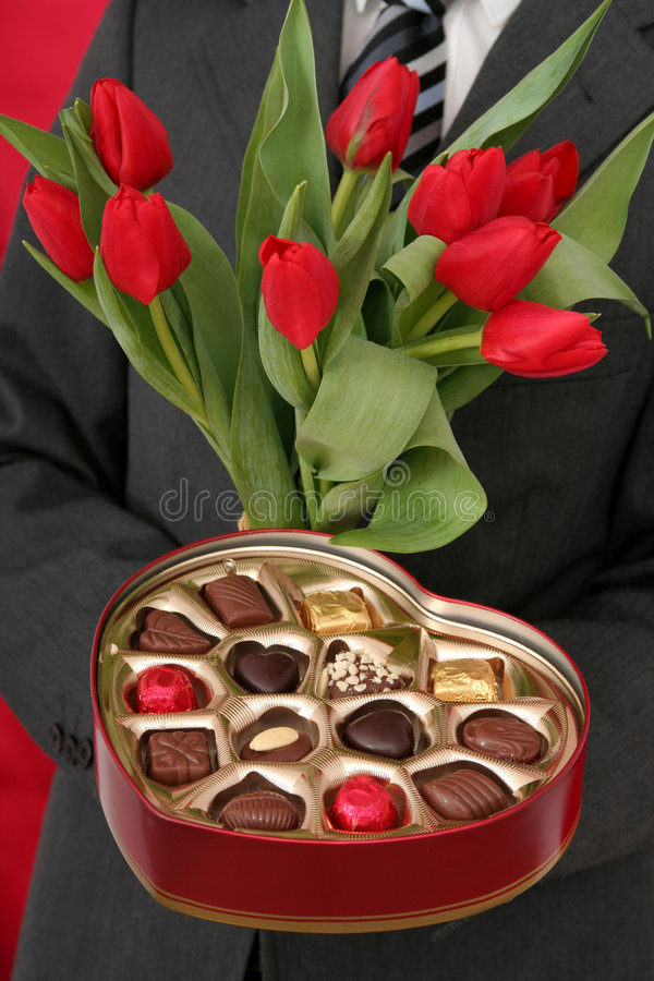 Download Man Holding Heart Shaped Box And Tulips Royalty Free Stock Photos - Image: 461038
