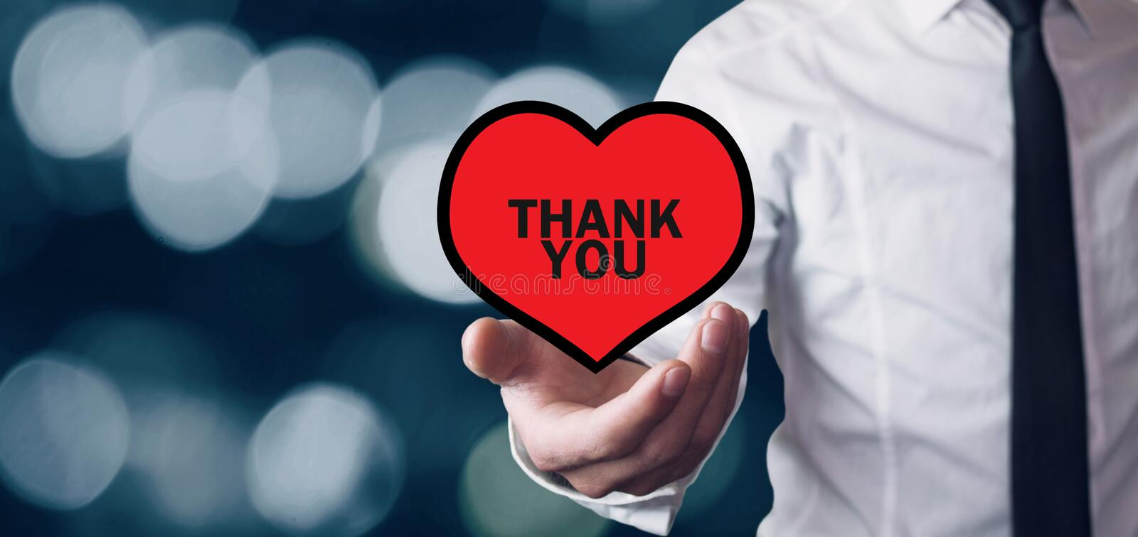Man holding heart. Thank You message on a red heart stock photo