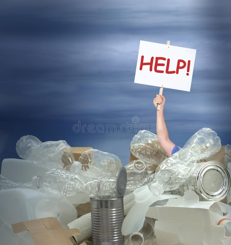 Man holding Help! sign in giant pile of recyclable containers products representing environmental challenges. Giant pile of recyclable plastic containers, tin stock photos