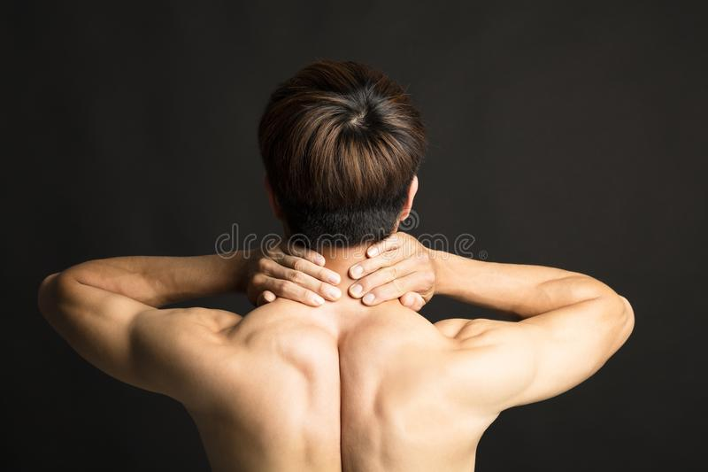 Man holding her neck in pain stock image
