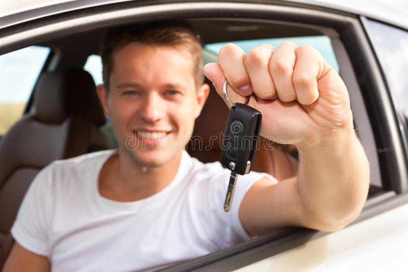 Man is holding his car key sitting inside royalty free stock photos