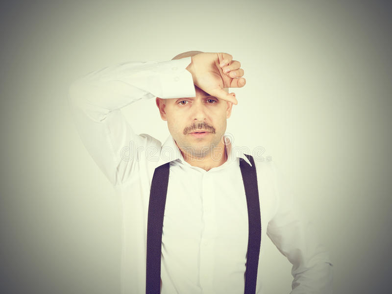 Man holding his head pain. royalty free stock photo