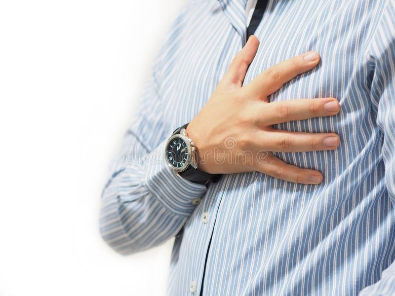 Man holding his heart with his hand stock photos