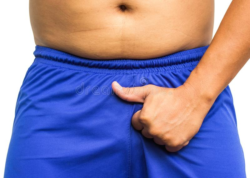 man holding his penis in his shorts, showing thumb up. No problems in the potency stock photos