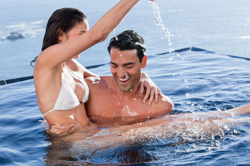 Download Man Holding His Playful Wife Stock Photo - Image: 22236662