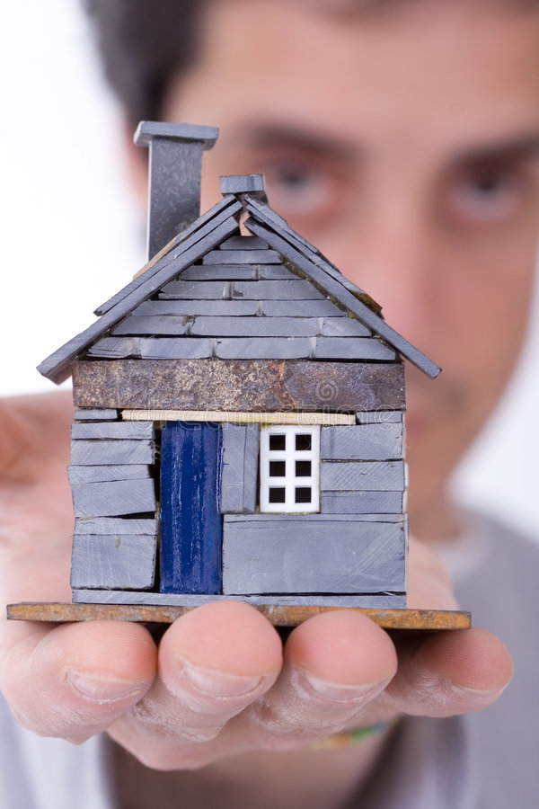 Man_holding_house royalty free stock photography